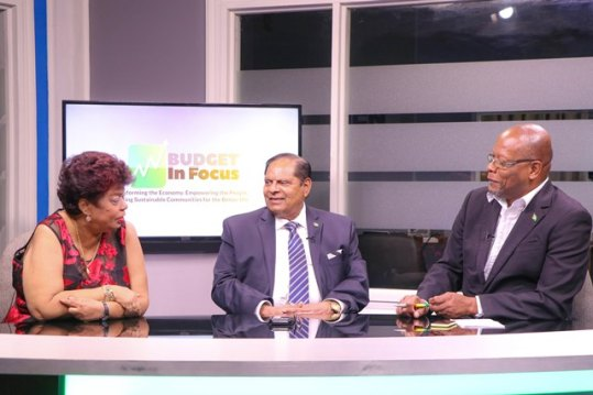 Minister of Social Protection, Amna Ally [left] and Prime Minister, Moses Nagamootoo [centre] during the televised Budget in Focus programme on the National Communications Network with Host, Enrico Woolford [right].
