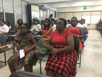 A section of the audience at the Christmas Cheer and Book Drive Drawing held at the University of Guyana Berbice Campus.
