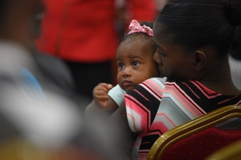 A teen mother and baby who attended the brief handover ceremony.