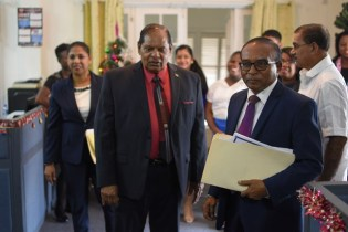 Prime Minister, Moses Nagamootoo and Chairman of the Integrity Commission, Kumar Doraisami.