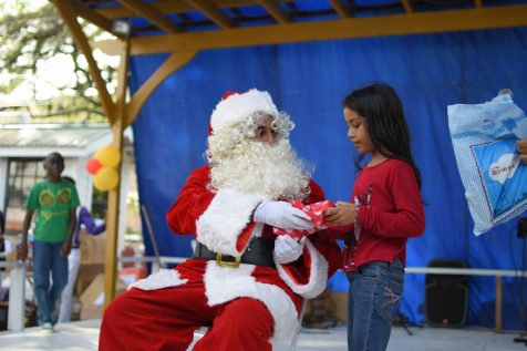 Santa Clause gives a child a present