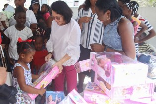 First Lady Ms. Sandra Granger sharing gifts to the little ones of Buxton.