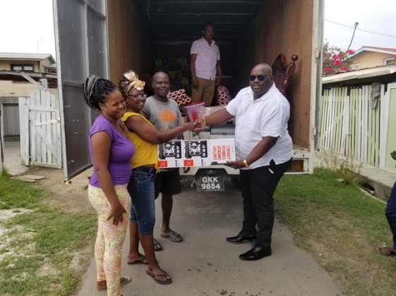 Director of Regional Health Services, Jevaughn Andrew Stephen handing over the items to the three families.