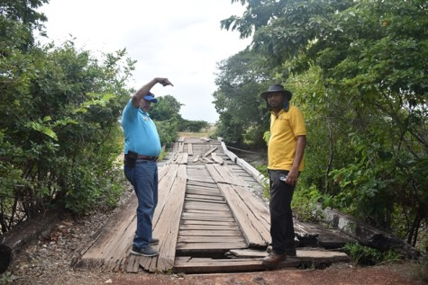 Minister of Indigenous peoples' Affairs, Sydney Allicock along with Minister of Public Infrastructure Engineer, Raphael Lewis inspecting one bridges, linking the communities, slated to be rehabilitated.