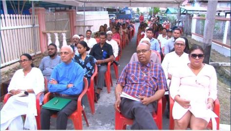 Minister of Communities, Ronald Bulkan with other attendees at the Lusignan massacre remembrance.