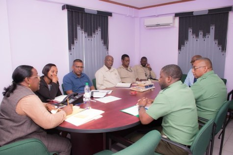 Minister within the Ministry of Natural Recourses, Simona Broomes, meeting with mining operators and other members of the public at her office.