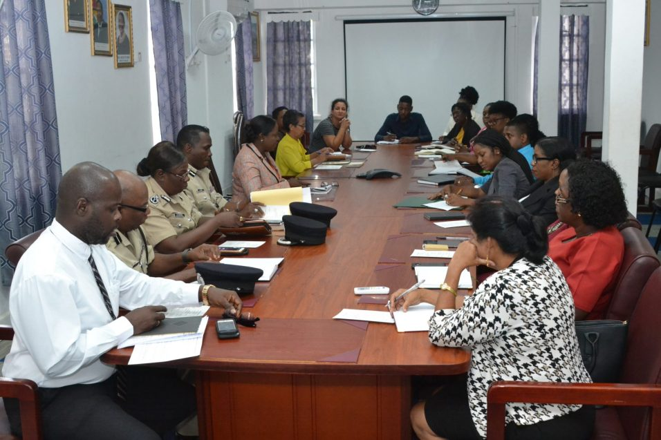 Minister of Education, Dr. Nicolette Henry [seated left, centre of the table] flanked by officials from the Guyana Police Force (GPF), School of the Nations and senior officers of the Ministry of Education
