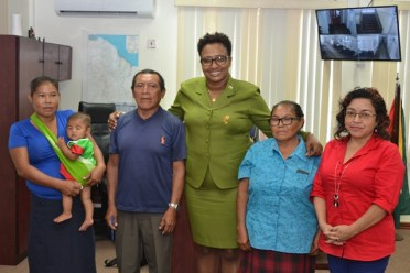 Minister within the Ministry of Public Infrastructure, Annette Ferguson with residents of Chinoweng, after completing consultation with the minister.