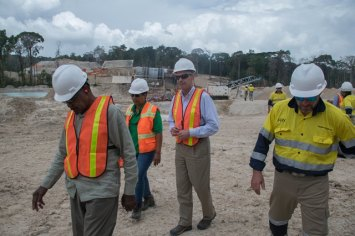 CEO of First Bauxite Corporation, Bill Rice and Director, Ian Christie tour Bonasika Mining Project with Government Ministers.