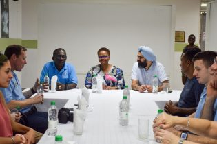 In the photo, from left to right] Chief Executive Officer of the GPHC, Brigadier George Lewis, Minister of Public Health, Volda Lawrence, Operation Walk Maryland (OWN), Co-Founder, Dr. Paul Khanuja with respective staff talking about the way forward