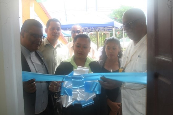 Mabaruma Tax Officer Lucy Marques cutting the ribbon to the new GRA office in the company of Minister of Finance, Winston Jordan and Chairman of Region One, Brentnol Ashley.
