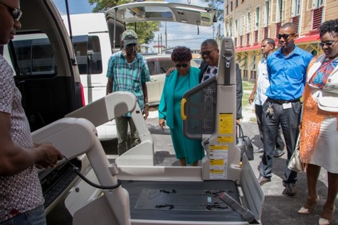 Minister of Social Protection, Amna Ally and Director of Childcare and Protection Agency, Ann Greene observing a demonstration exercise of the Special Need Bus.