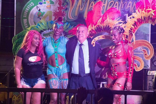 Minister of Social Cohesion, Dr. George Norton with a few of the costume models for Mash 2019.