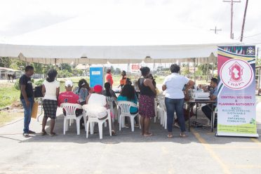 A small gathering of residents awaiting registration