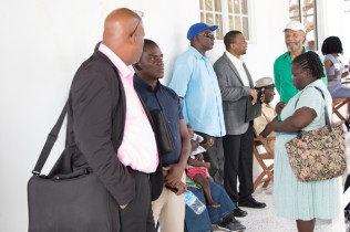 Members of the public waiting to meet with Minister of Natural Resources, Raphael Trotman.