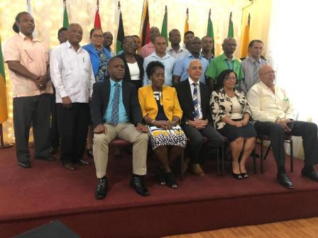 Minister of Communities, Ronald Bulkan and Minister within the Ministry, Valerie Adams-Yearwood [seated in front row] flanked by departmental heads.
