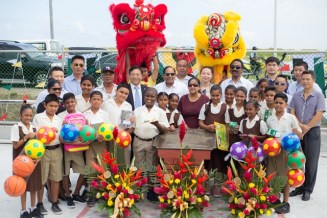 Prime Minister Moses Nagamootoo, his wife, Mrs. Sita Nagamootoo, Ambassador to the People's Republic of China, Cui Jianchun, Attorney General and Minister of Legal Affairs, Basil Williams SC., along with students of the Winsor Forest Primary School and members of the Chinese community.