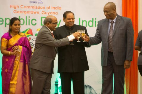 Prime Minister Moses Nagamootoo, H.E. V. Mahalingam and Minister of State Joseph Harmon toast to the prosperity of India and Guyana's bilateral relations