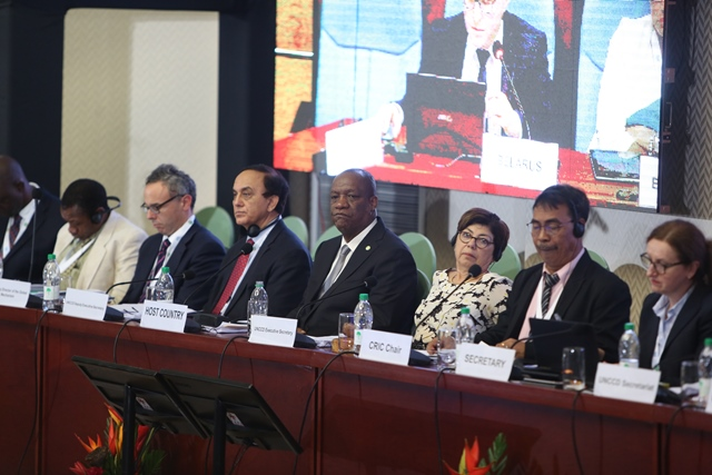 Minister of State Joseph Harmon and Executive Secretary of the UNCCD Monique Barbut.