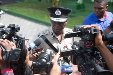 Commissioner of Police, Leslie James, being questioned by members of the media.