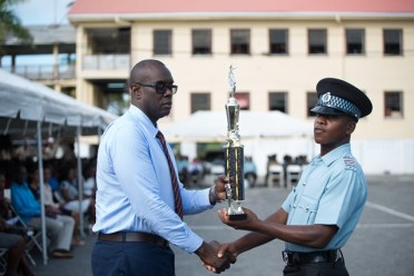 Head of Special Branch, Nigel Hoppie presenting the best student award to one of the graduates.