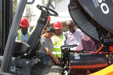 Managing Director Mr. Andrew Astwood, Senior Manager Administration, Ms. Mohini Somaroo and Terminal Manager, Mr. Asford Glen inspecting the forklift trucks.