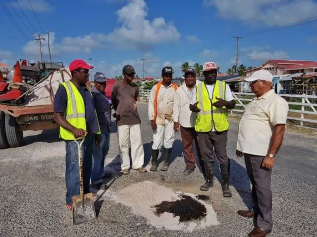 REO Jaikaran being briefed by workers from the Public Infrastructure Department as they upgrade roads in the region.