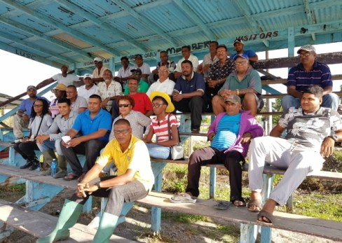 –(seated second row fourth from right) Entomologist Dr. Viviane Baharally from Guyana Rice Development Board (GRDB) and at centre is Regional Executive Officer Denis Jaikaran surrounded by farmers.
