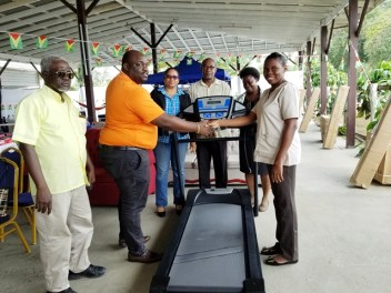 Director of Regional Health Services of Region 6, Jevaughn Andrew Stephen handing over the treadmill to a doctor attached to the physiotherapy department. Looking on are Regional Executive Officer, Kim Williams Stephen, Focal point coordinator and advisor to the Minister of Public Health, Alex Foster, and Matron of the New Amsterdam Hospital.