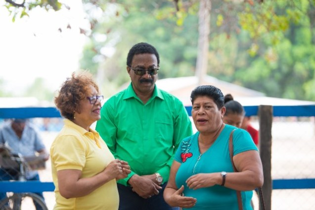 Attorney General and Minister of Legal Affairs, Basil Williams SC., and Minister within the Ministry of Indigenous Peoples' Affairs, Valerie Garrido-Lowe interacting with a resident of Karasabai.