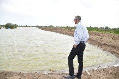 Minister of Business, Dominic Gaskin taking a better view of the large ponds at the farm.