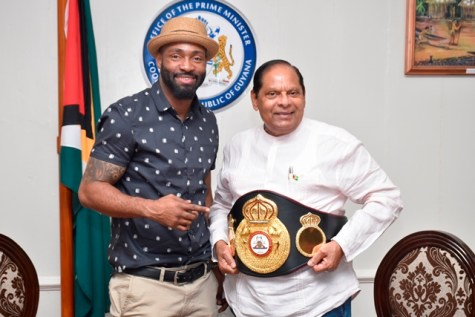 Prime Minister Moses Nagamootoo and WBA Super Middleweight Boxing Champion Lennox 'Too Sharp' Allen.