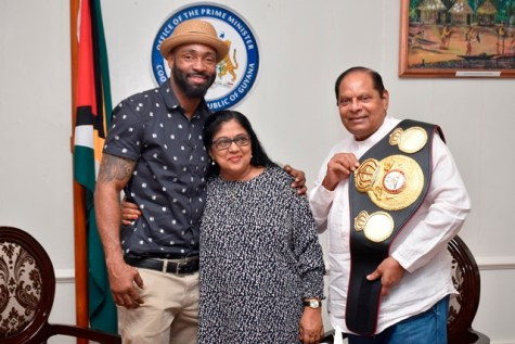 Prime Minister Nagamootoo and Mrs Sita Nagamootoo along with Boxing Champion Lennox 'Too Sharp' Allen.
