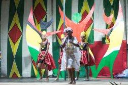 Young Calypso performers on stage entertain the crowd to sweet melody
