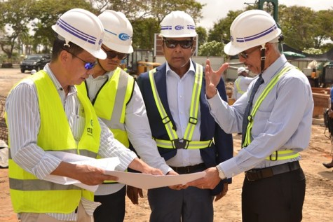 Minister of Business, Dominic Gaskin examines the hotel design.