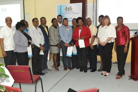 Minister of Education. Dr. Nicolette Henry and Vice-Chancellor of the University of Guyana, Professor Ivelaw Griffith flanked by the new board members.