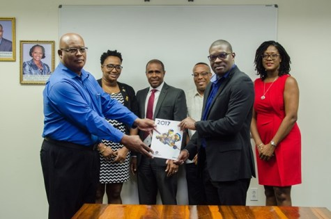 Chairman of the Board of Directors for the Power Producers and Distributors Incorporated (PPDI), Mark Bender presents the company's 2017 Annual report to Minister of Public Infrastructure, David Patterson as Minister within the Minister of Public Infrastructure, Annette Ferguson and other officials look on.
