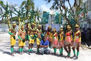 Costume designer, Jermaine Broomes and some of the revellers.