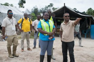 Minister within the Minister of Natural Resources, Simona Broomes visits a mining site along with Mines Manager of the Guyana Geology and Mines Commission (GGMC), Krishna Ramdass.