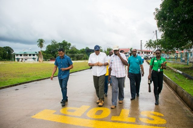Minister of Natural Resources, Raphael Trotman, walks along a paved section of the Mahdia Main Road during his visit to the region on Thursday February 7th, 2019.