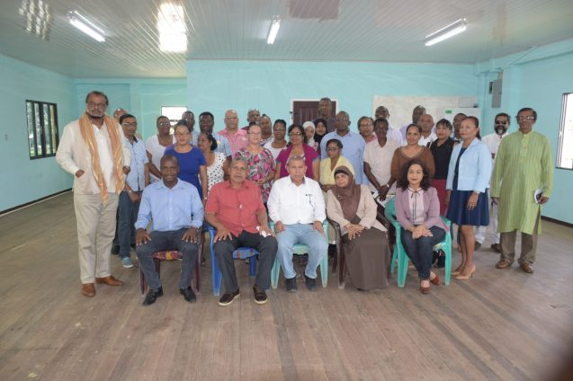 [In the photo, front row left to right] Mayor of Bartica, Gifford Marshall, Chairman Gordan Bradford, Minister of Social Cohesion, Dr. George Norton, Coordinator (ag), Natasha Singh-Lewis, Technical Officer, Pamela Nauth