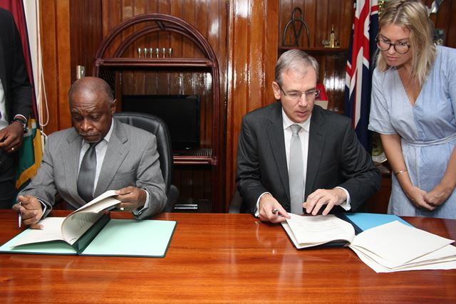 Vice President and Minister of Foreign Affairs, the Honourable Carl B. Greenidge and High Commissioner Designate of New Zealand to the Cooperative Republic of Guyana, His Excellency Anton Ojala sign the Air Services Agreement.