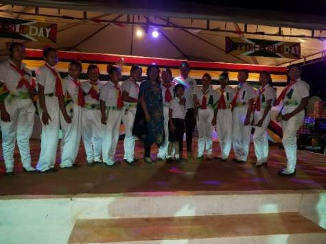 Minister of Public Affairs Dawn Hastings-Williams and some of the young people who participated in the cultural programme at Lethem's 49th Republic Anniversary celebration.
