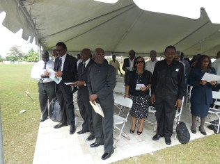 (From right) Minister within the Ministry of Social Protection Keith Scott, Regional Chairman Renis Morian, Minister of Legal Affairs and Attorney General Basil Williams S.C. and other regional and government officials paying homage to Horace James.