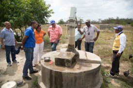 Minister of Public Telecommunications, Catherine Hughes, Managing Director of Guyana Water Incorporated (GWI), Dr. Richard Van West-Charles and other officials examine a pump