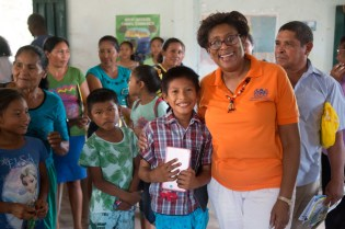 Minister of Public Telecommunications, Catherine Hughes and one of the young residents