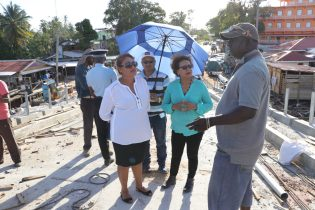 Minister within the Ministry of Indigenous Peoples' Affairs, Valerie Garrido-Lowe and Toshao of Santa Rosa, Whanita Phillips in discussion with the contractor on the Moruca Bridge