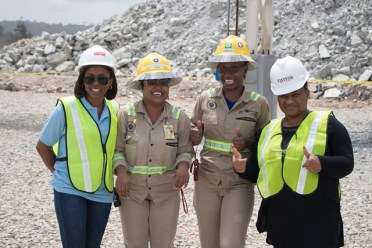 Two of Aurora's safety officers pose with Special Assistant to Minister Trotman, Shaundelle France [left] and Personal Assistant to Deputy Minister Oliphant, Kefilwe Chibogo [right].
