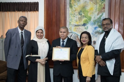 [In the photo, from left to right] General Secretary of the Universal Peace Federation, Rev. Ronald Mc Garrell, Spirit Mother Latchmin Khan, Minister of Social Cohesion, Dr. George Norton, Spirit Mother Camila North and National Chairman of the Universal Peace Federation (UPF), Roshan Khan.