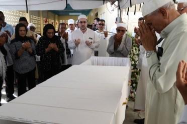Members of the Muslim Community reciting the Janaza prayer.